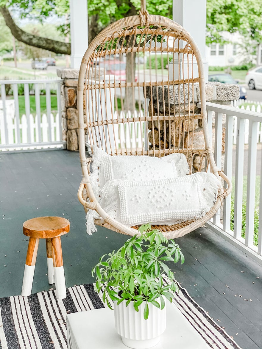 hanging chair on porch with stool