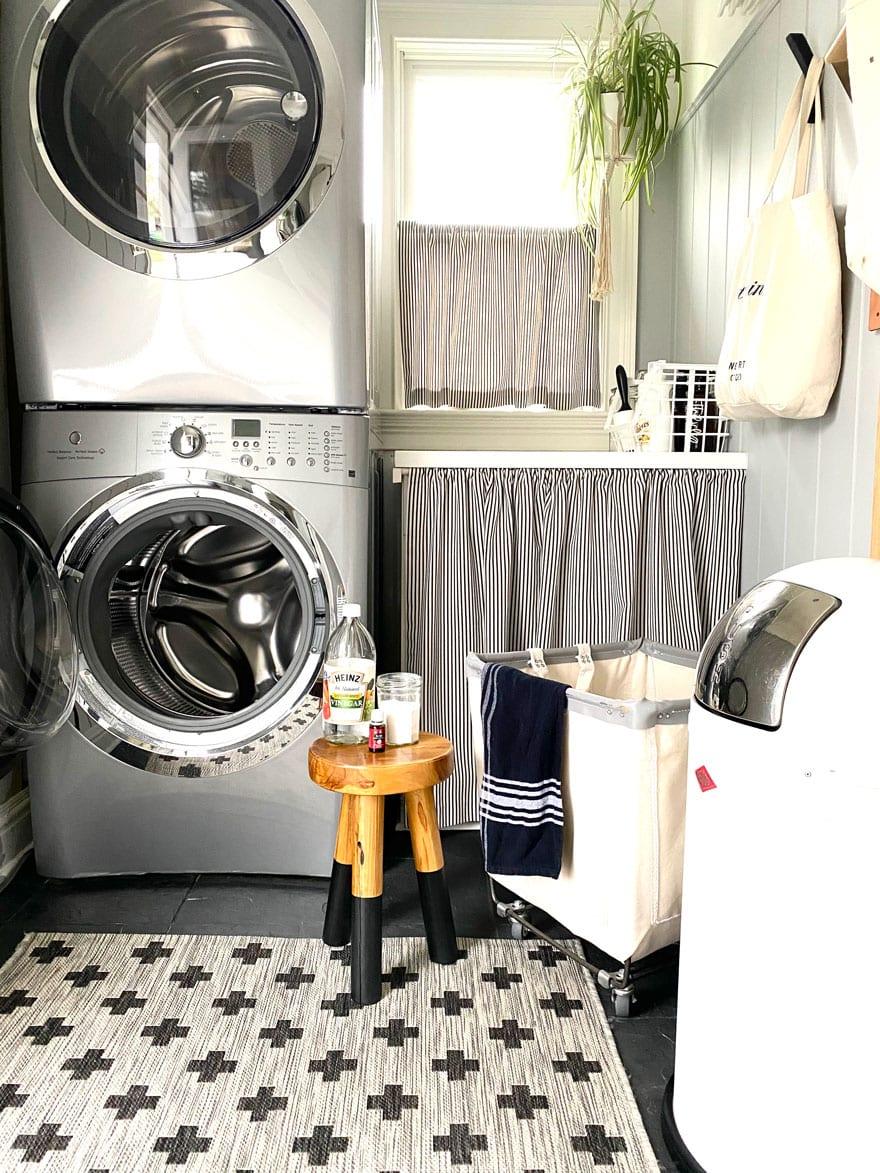 stool with vinegar, jar, oil, next to washing machine