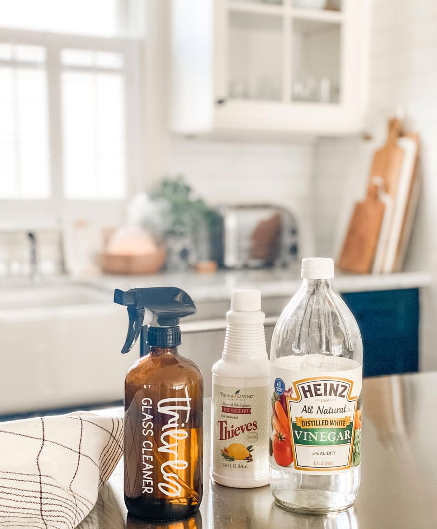 amber bottle with white label, vinegar and thieves on kitchen counter