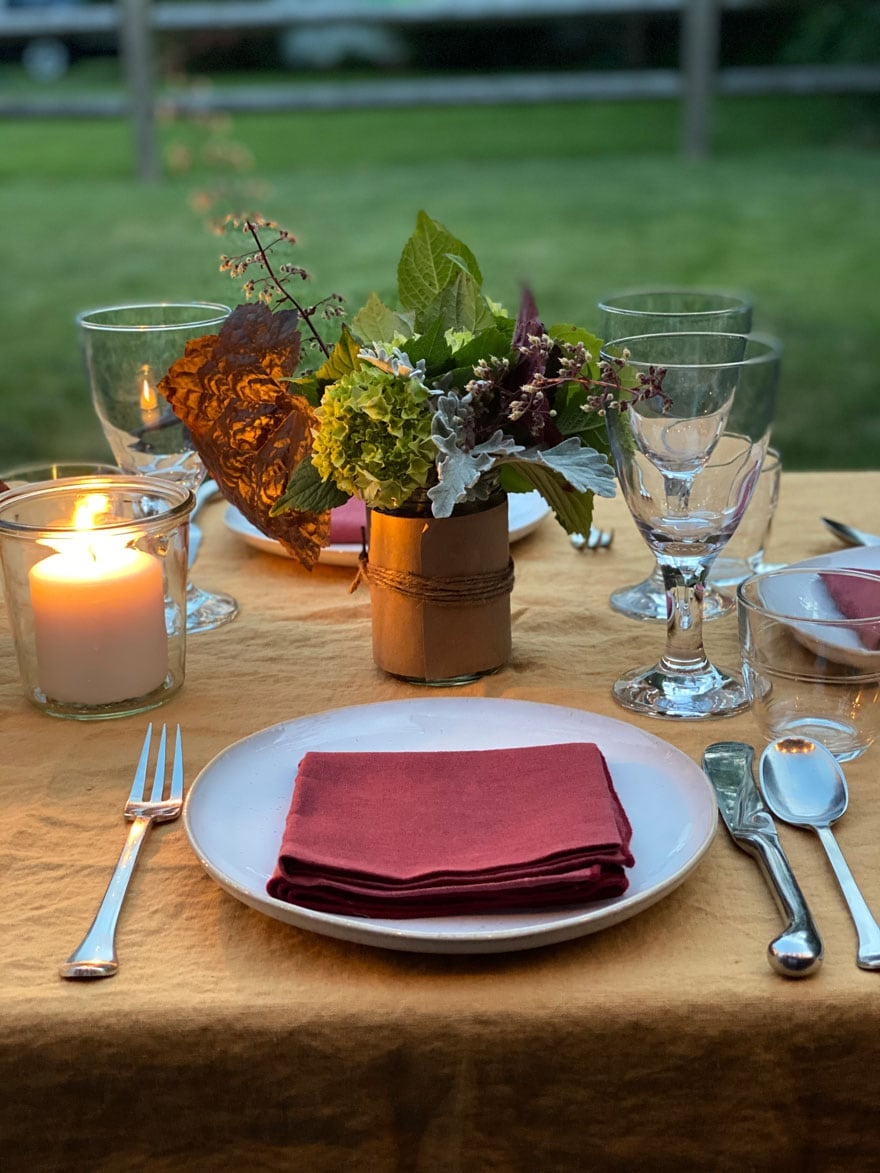 plate, napkin, candle, flowers