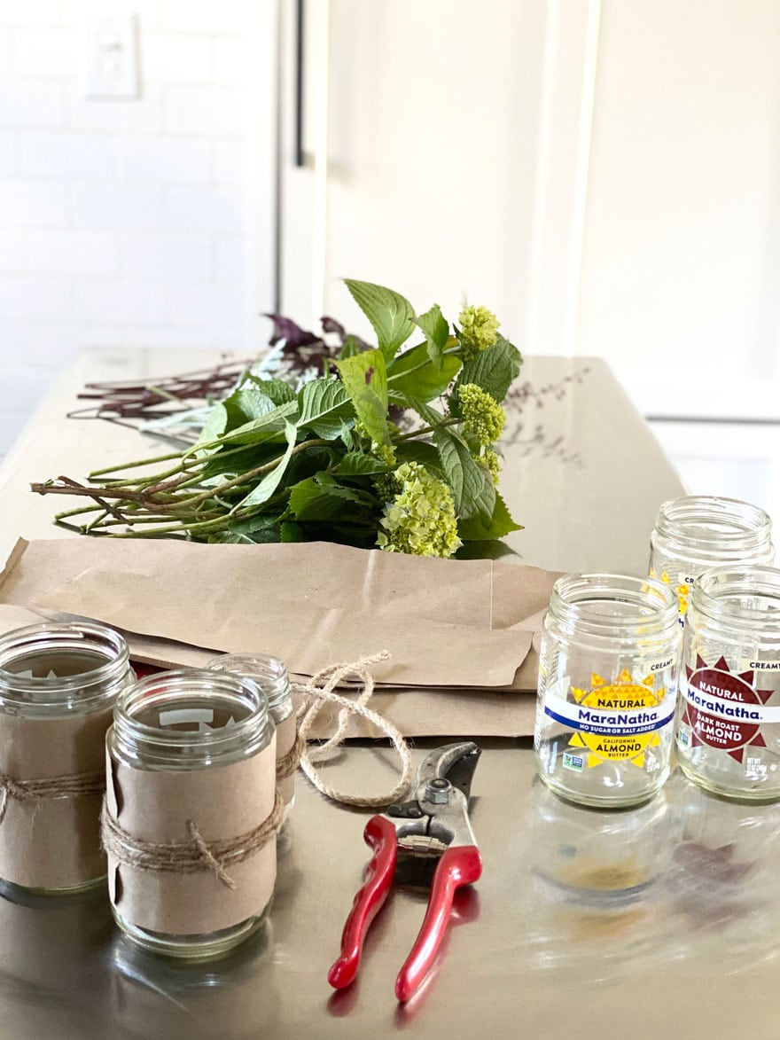 jars, clippers. flowers, paper bag