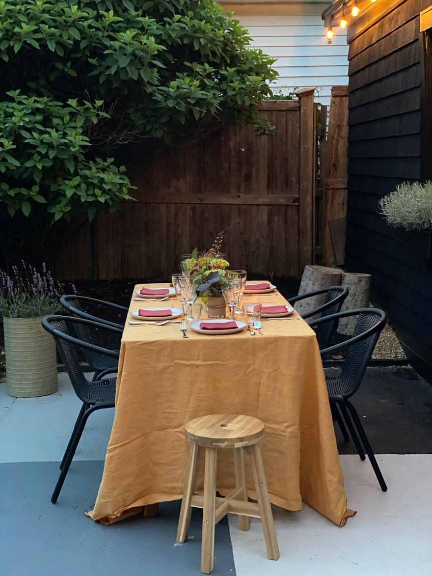 table with gold linen cloth outdoors