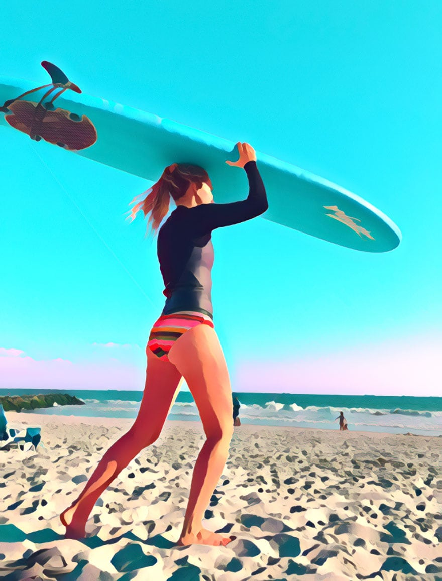 girl carrying surf board