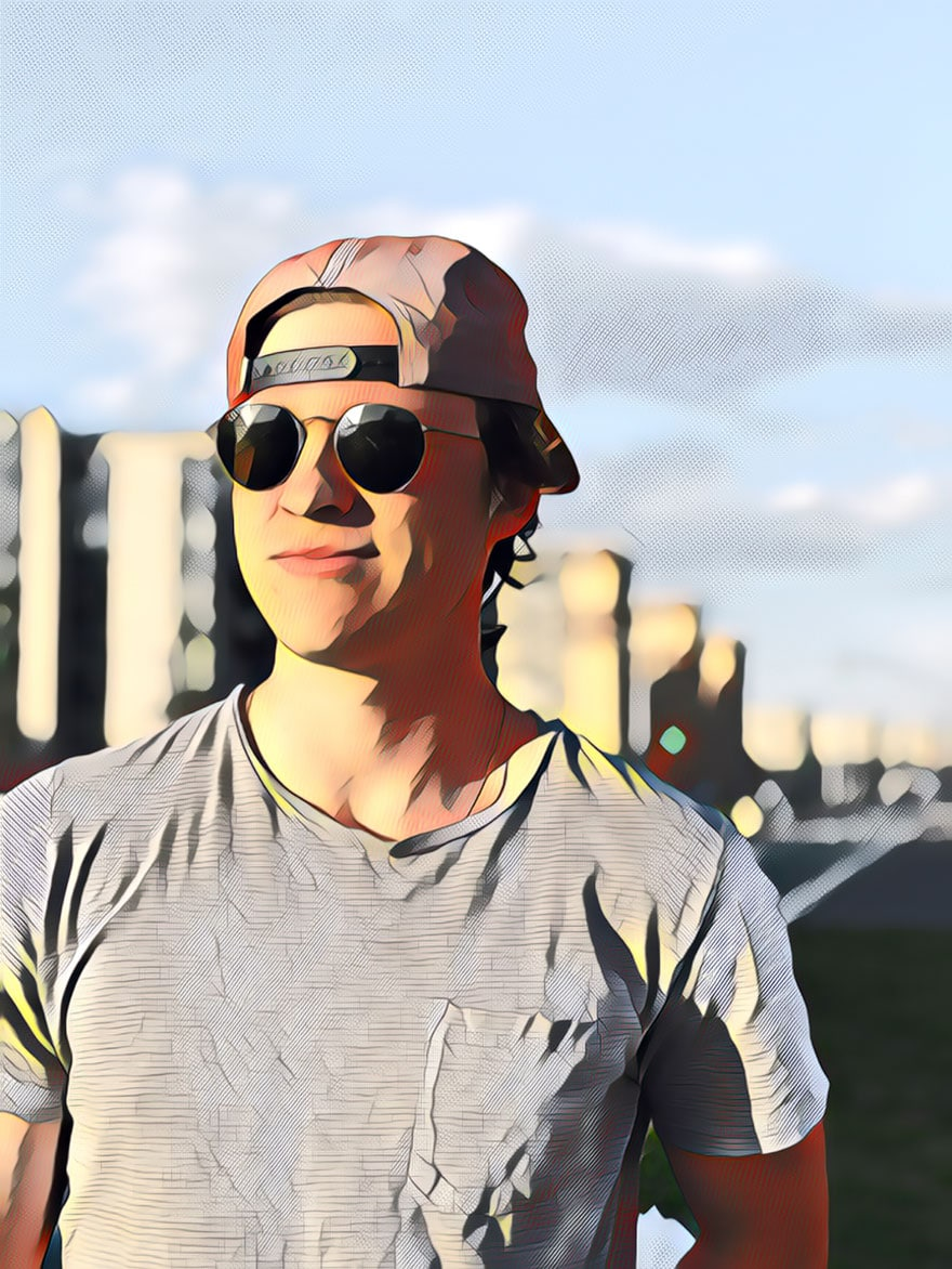 young man in backwards hat and sunglasses