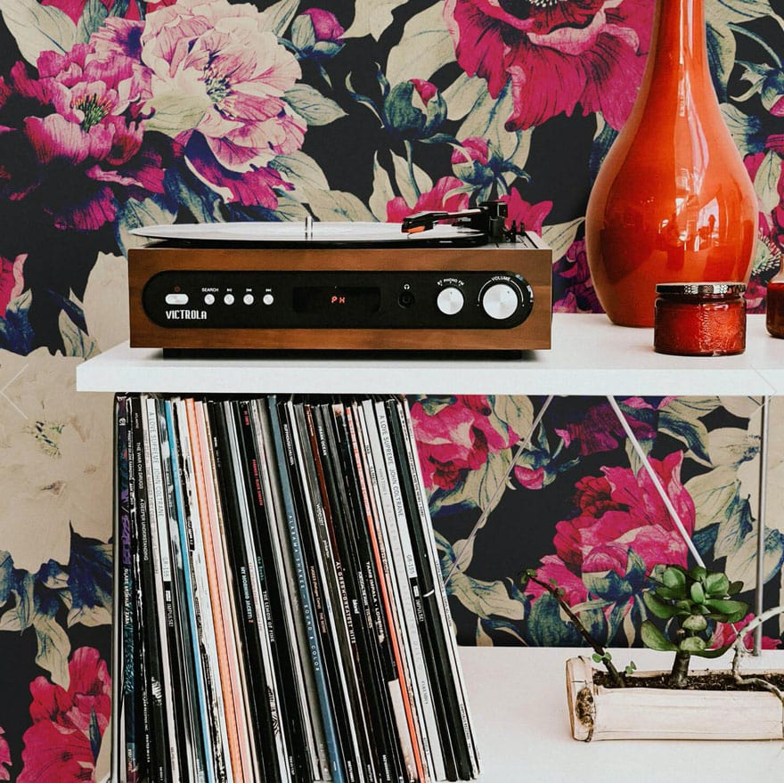 brightly colored wallpaper with record and red vase, candle in jar, record player