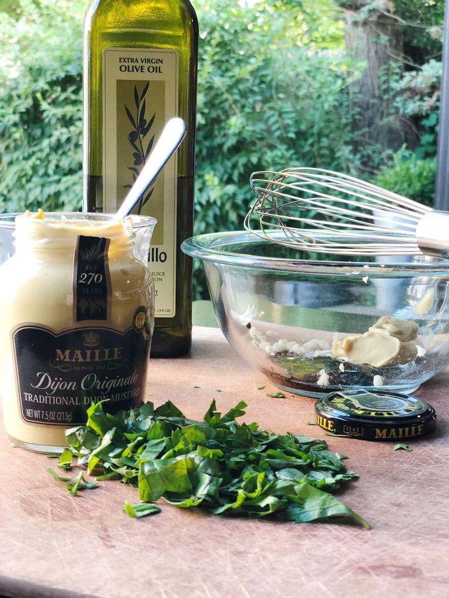 jar of mustard with fresh herbs