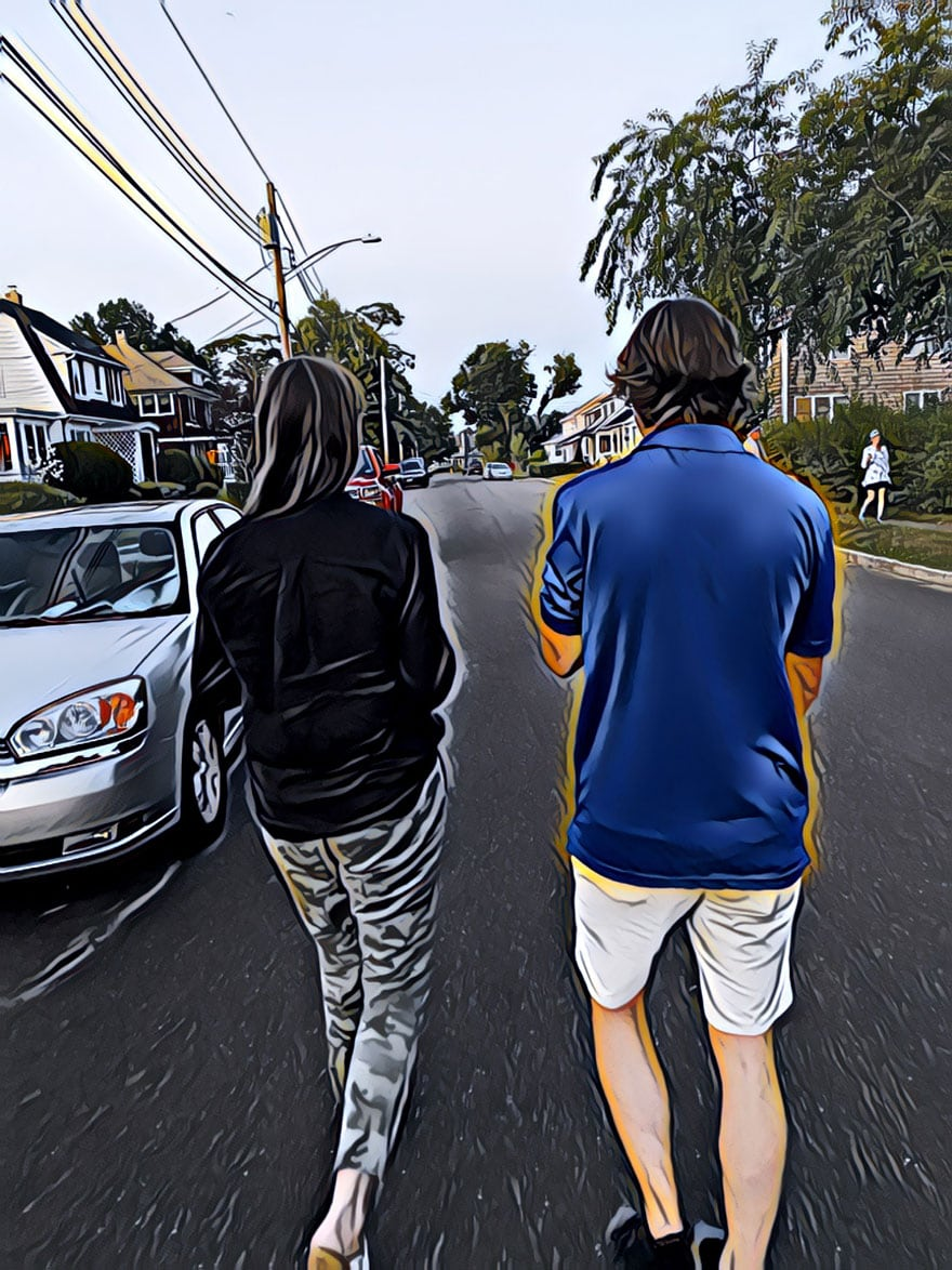 woman and young man walking