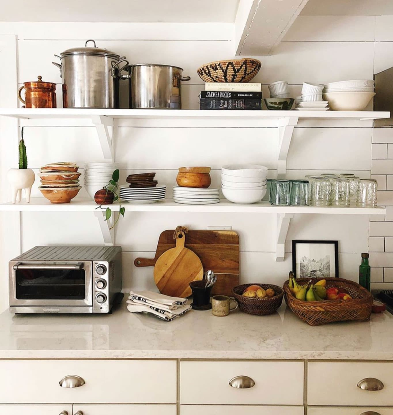 open shelving in the kitchen with flea market style in neutrals