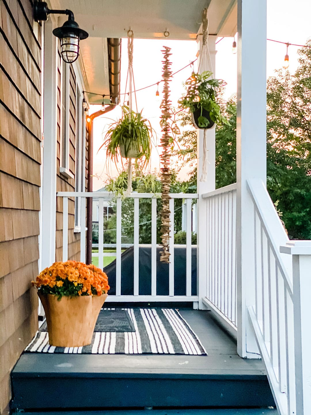 Lifestyle blogger Annie Diamond shares her simple fall decor on her back porch of her 1920s beach cottage in New England.