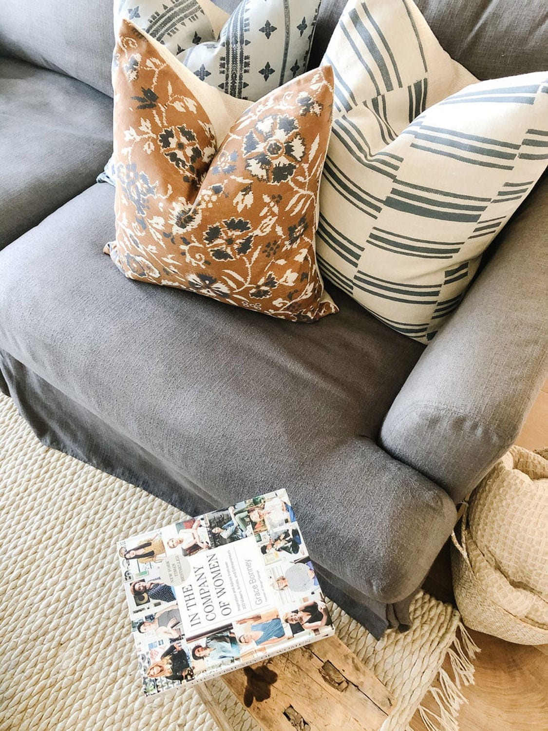 Pillows and book on soap and stool