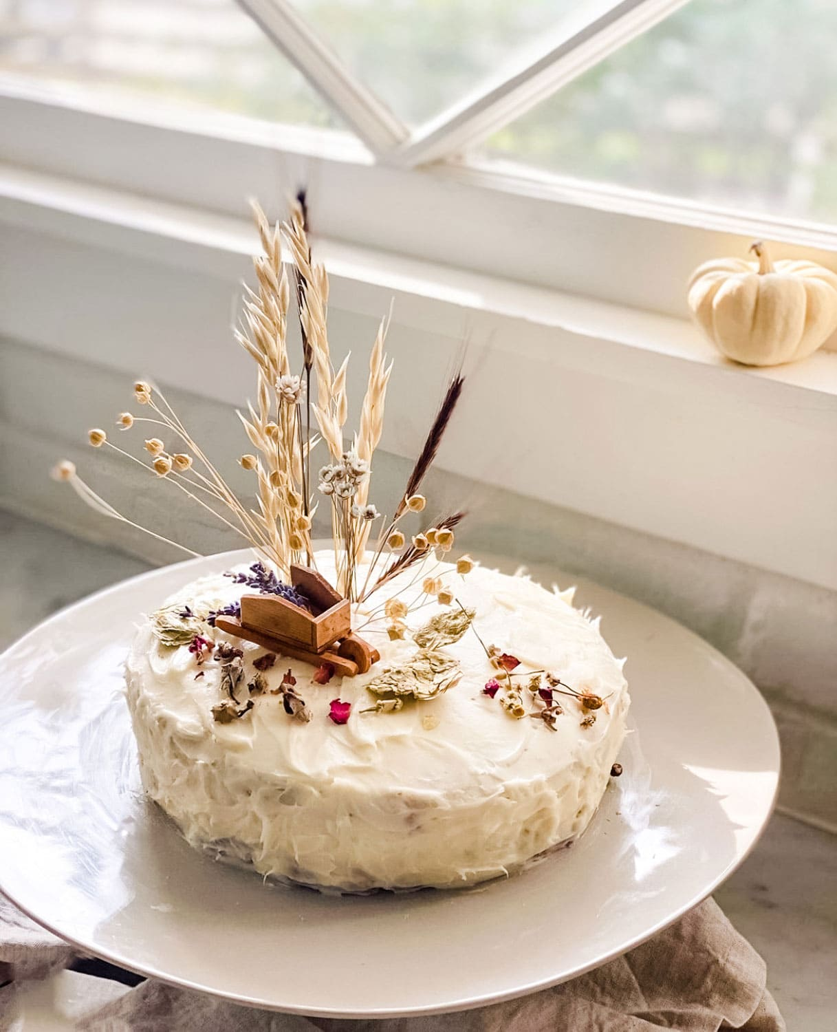 Decorated Cake on cake plate in front of old window