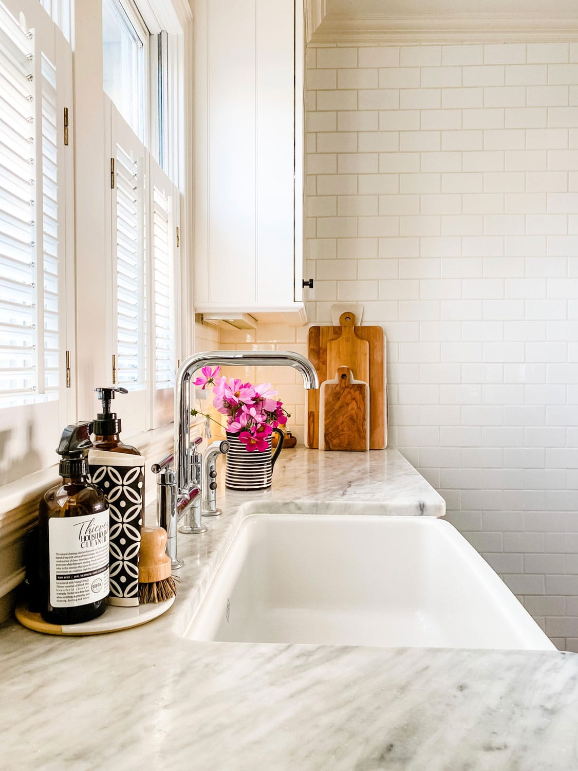 white kitchen with subway tile on wall