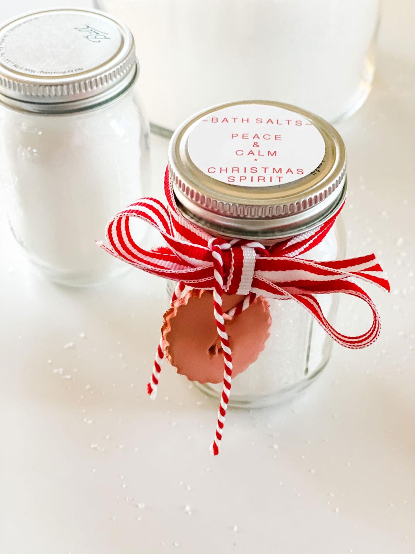 mini mason jar with bath salts and red and white ribbon