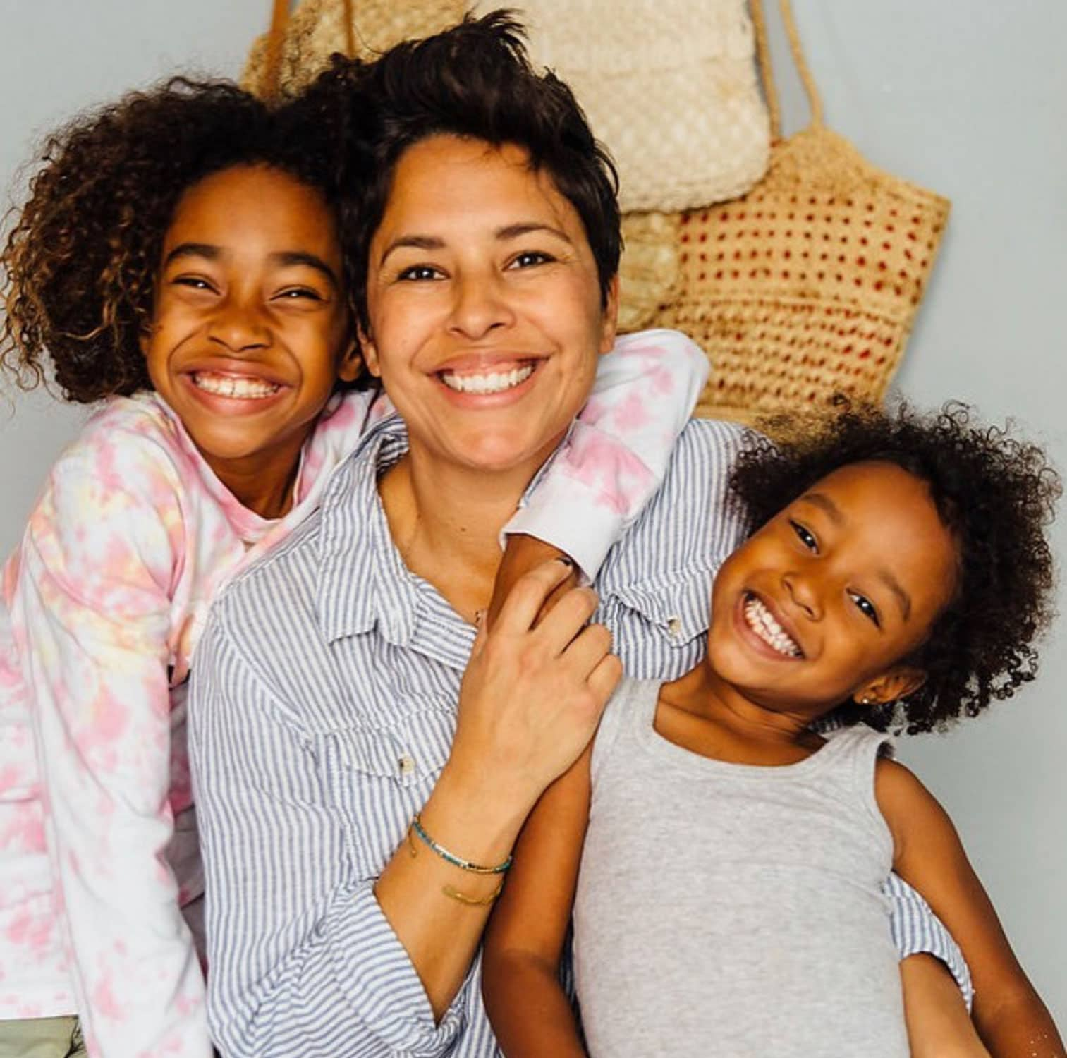 woman with two kids happy smiles