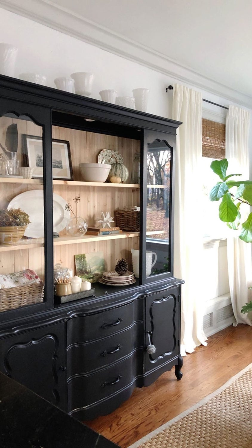 black hutch with raw wood shelves