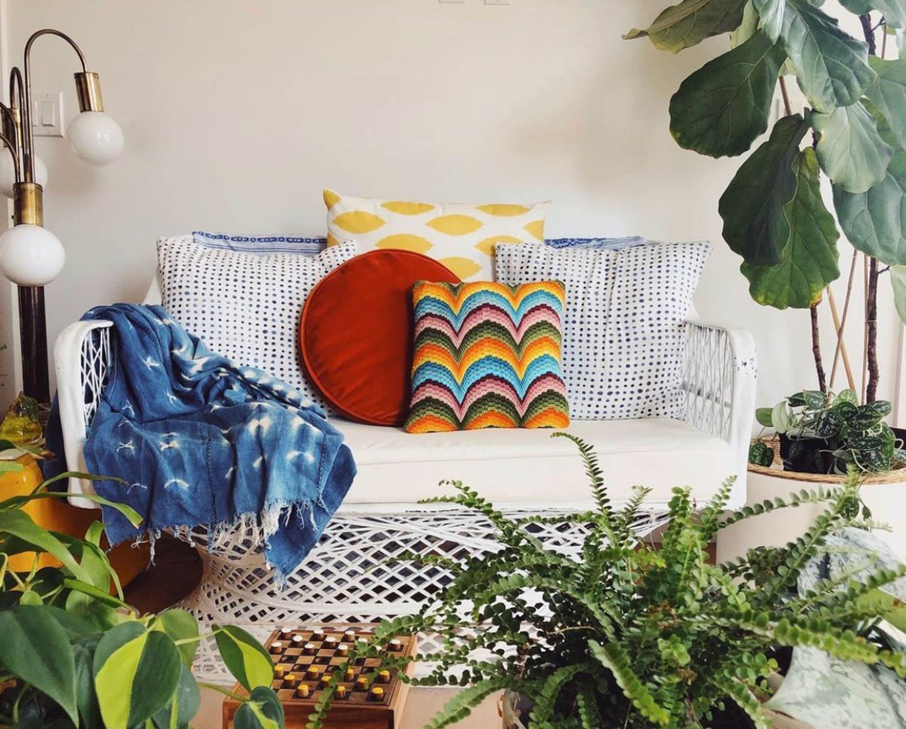 boho style sofa with pillows on wicker couch