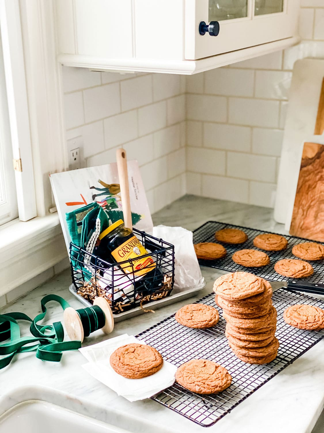 cookies on counter with basket and book