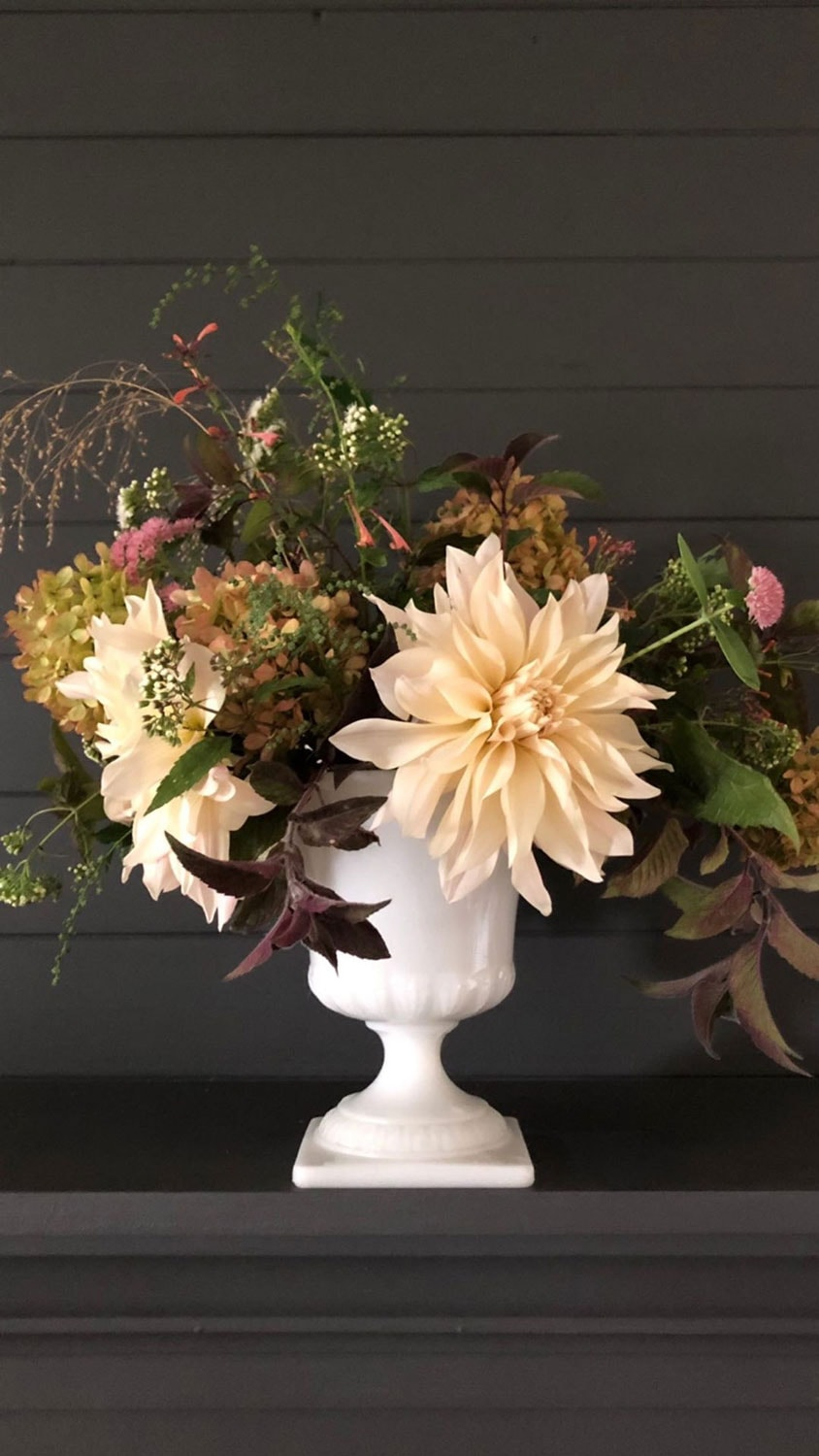 dahlias and foraged flowers in a vintage vase