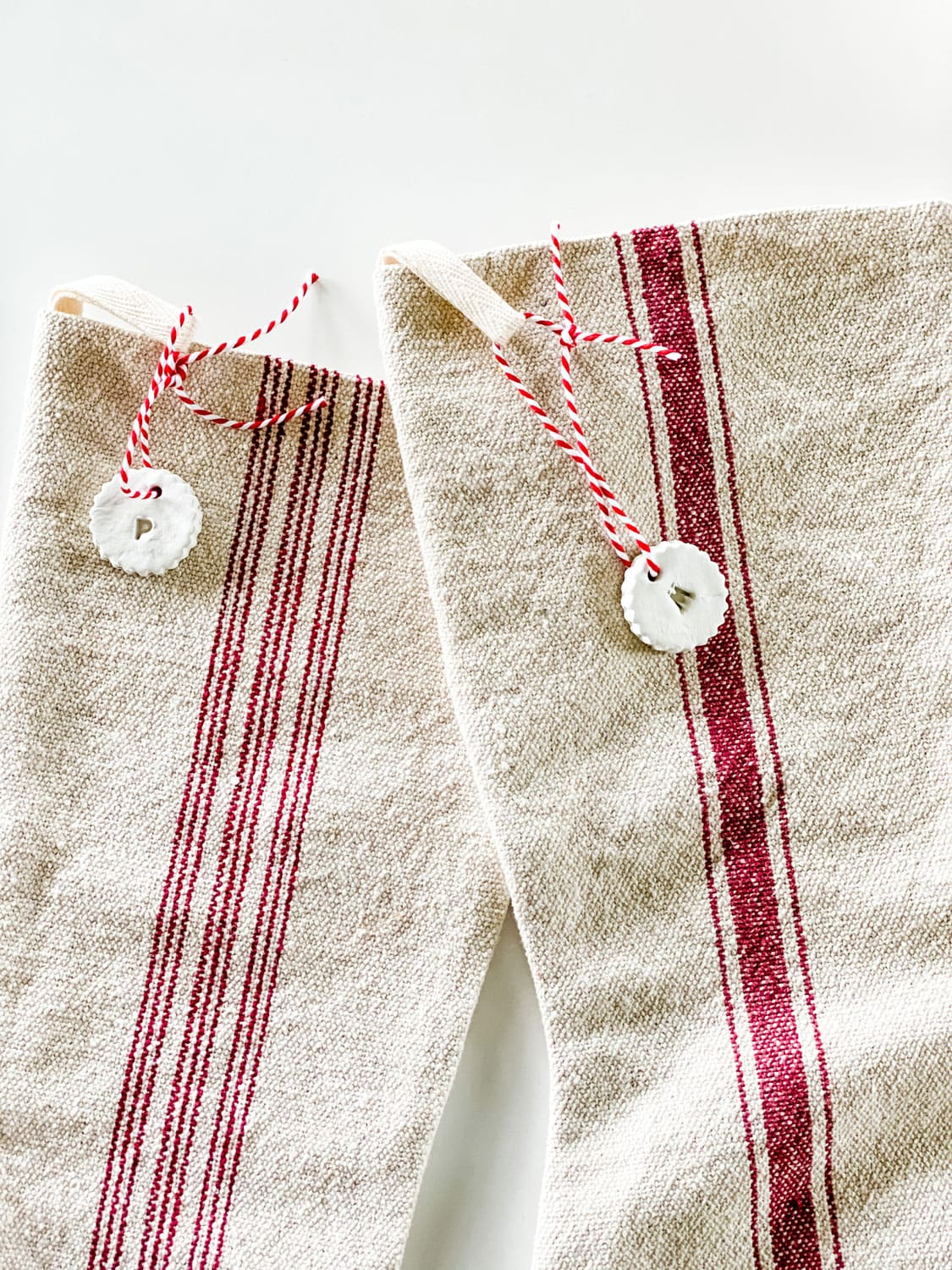 clay tags on Christmas grain sack stockings