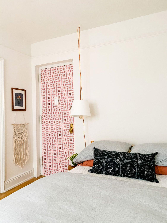 wallpaper on door, pendant lamp
