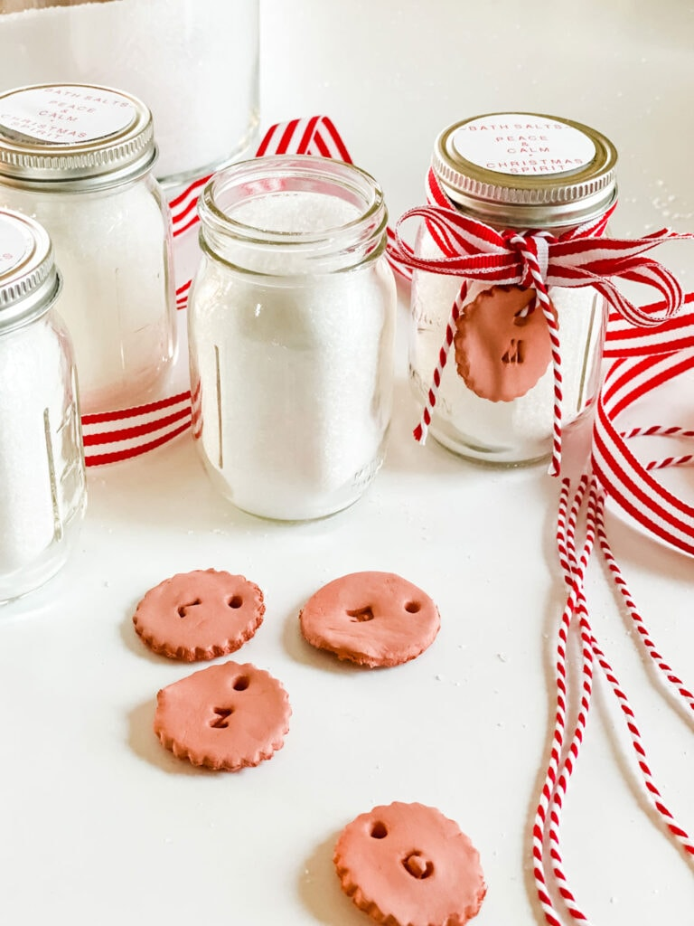 mini mason jar with bath salts and red and white ribbon and clay tag with twine