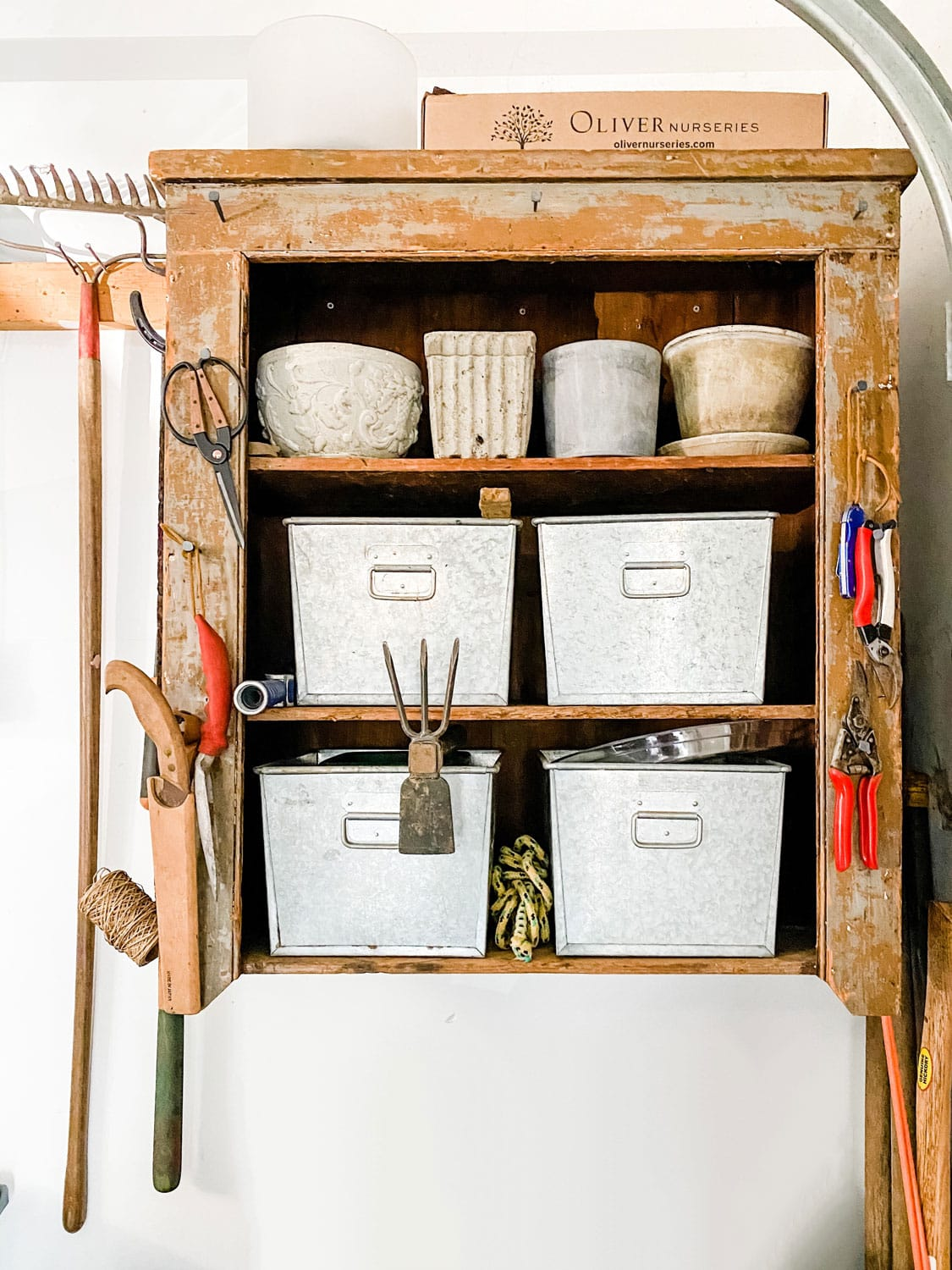 rustic garden hutch on walls with tools