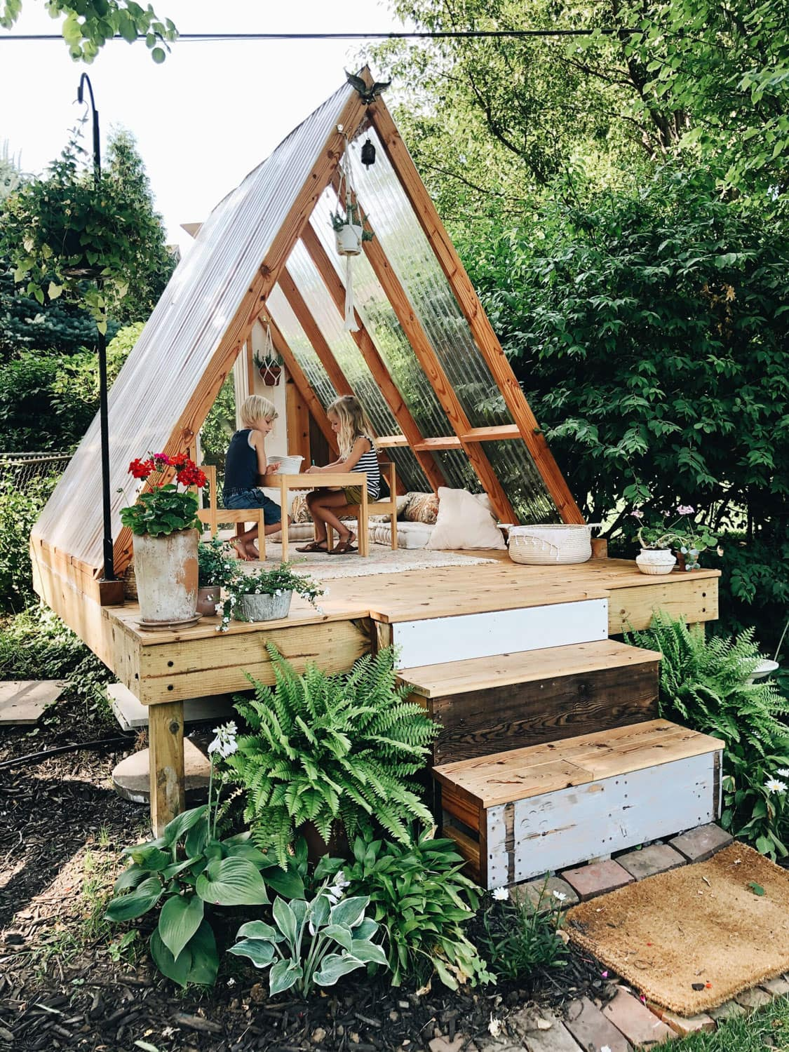 a-frame style scandi playhouse outdoors