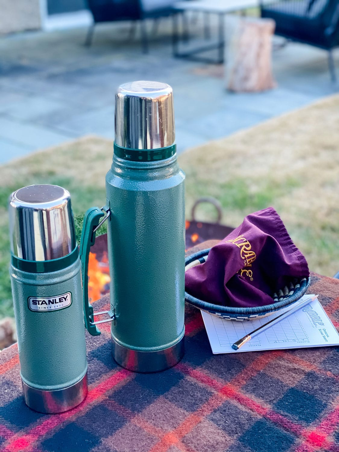 Stanley Thermos and scrabble piece bag on Pendleton blanket