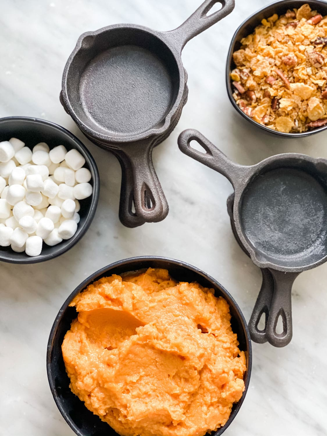 small bowls with sweet potatoes and marshmallows, mini lodge skillets
