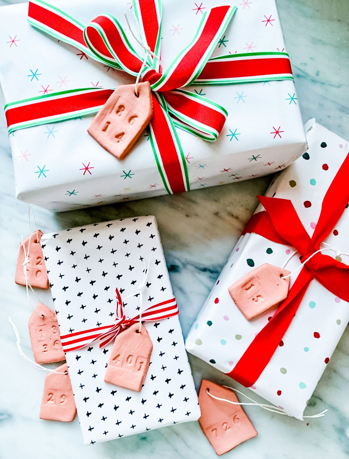 3 packages with ribbons and clay tags