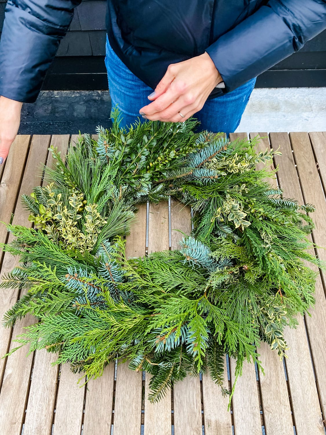 wreath on outdoor rustic table
