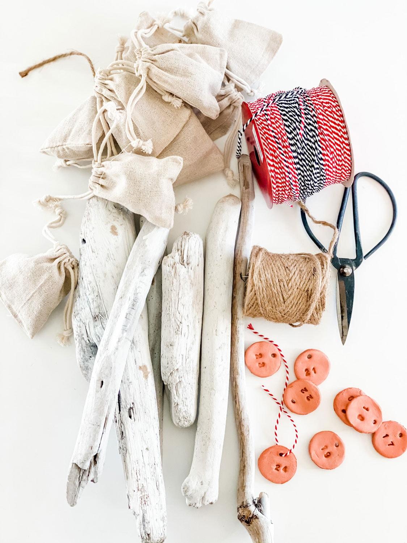 drift wood, twine, clay tags, scissors