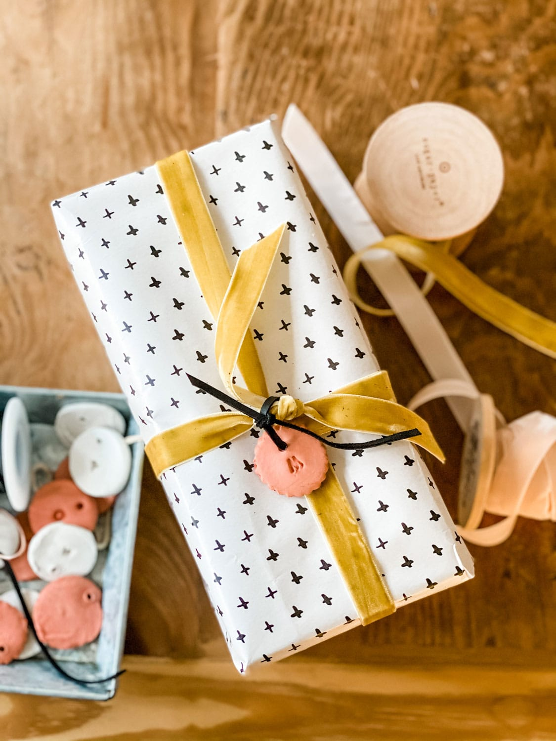 Gift wrapped with black and white paper and gold ribbon
