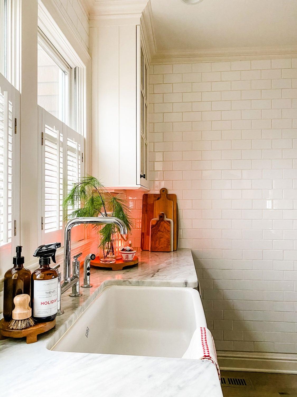 wood trivets, boards, subway tile at kitchen sink