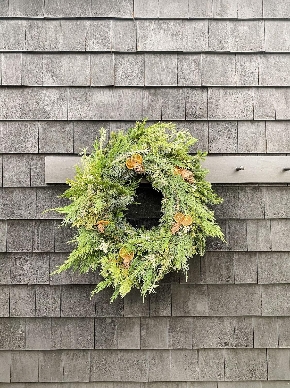 wreath on black shingle cottage