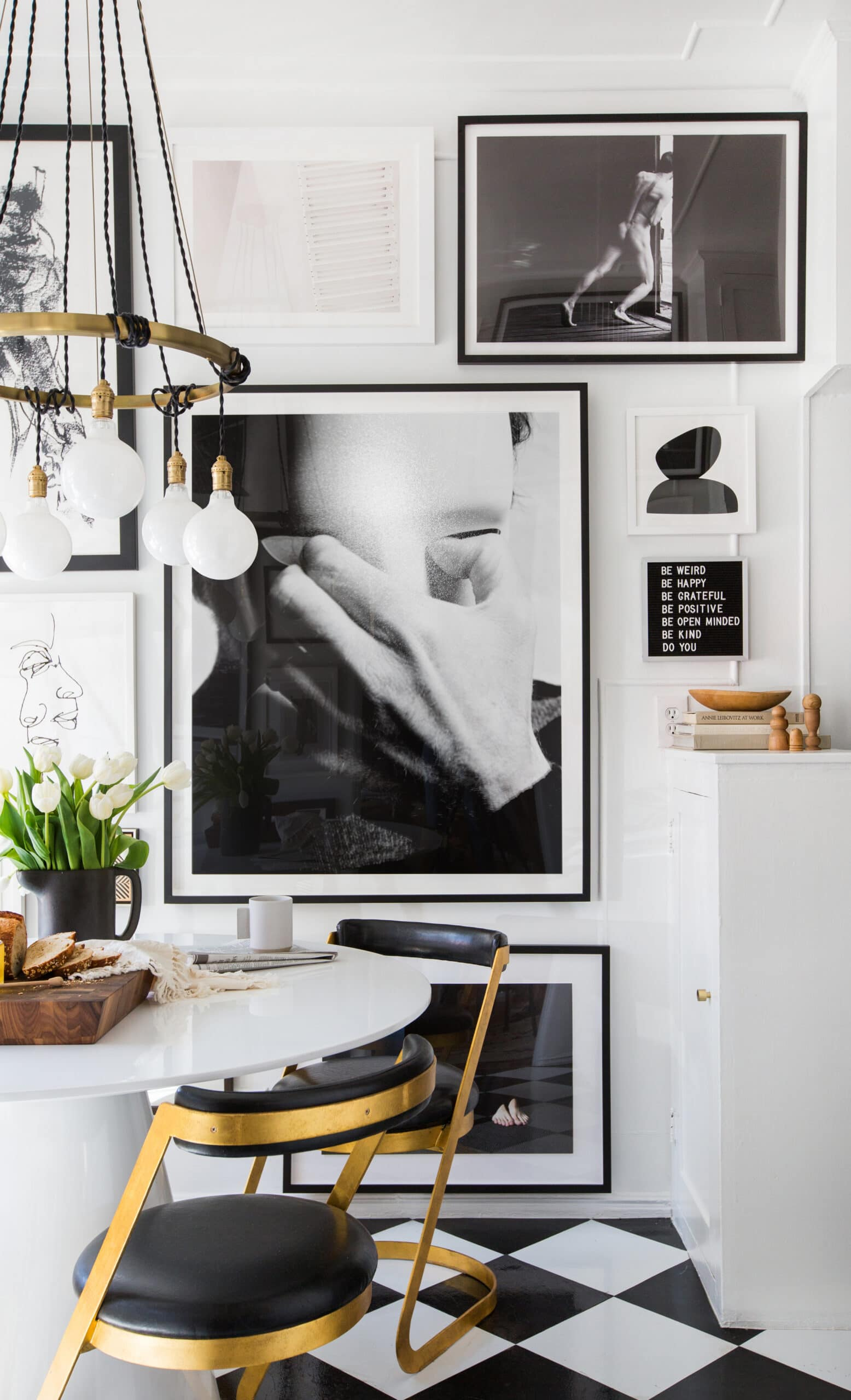 art collage wall in kitchen eating area
