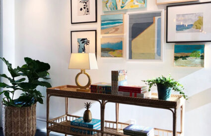 art above rattan console table plant, lamp