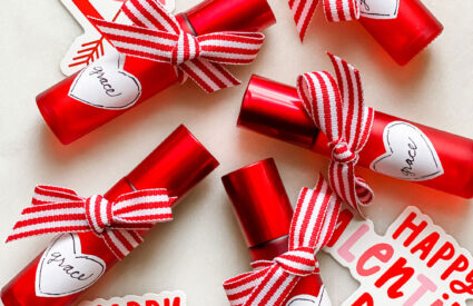 small red roller bottles with tag and ribbons