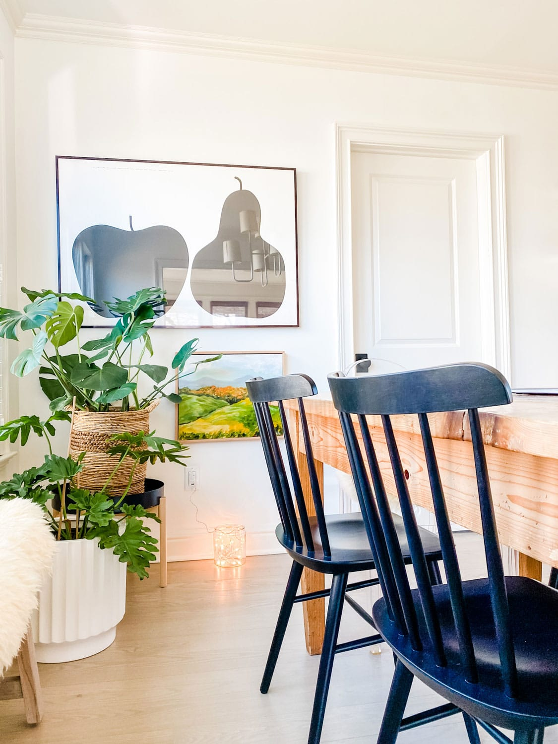 graphic poster and painting with plants in a dining room