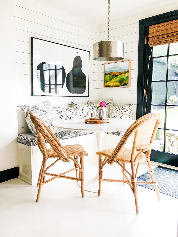 Saarinen table in corner kitchen with built in banquette