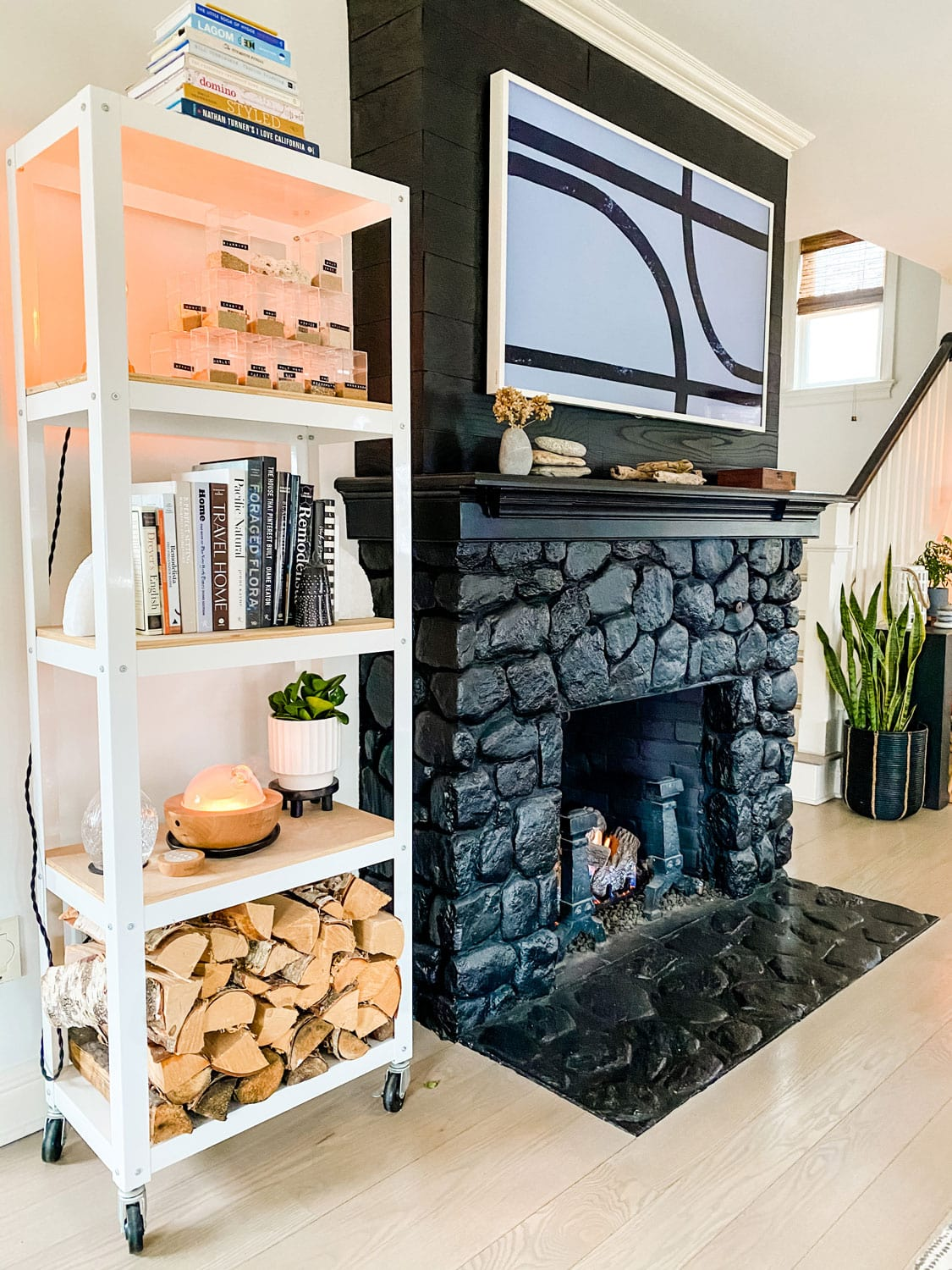 Black painted stone fireplace with Samsunf Frame TV