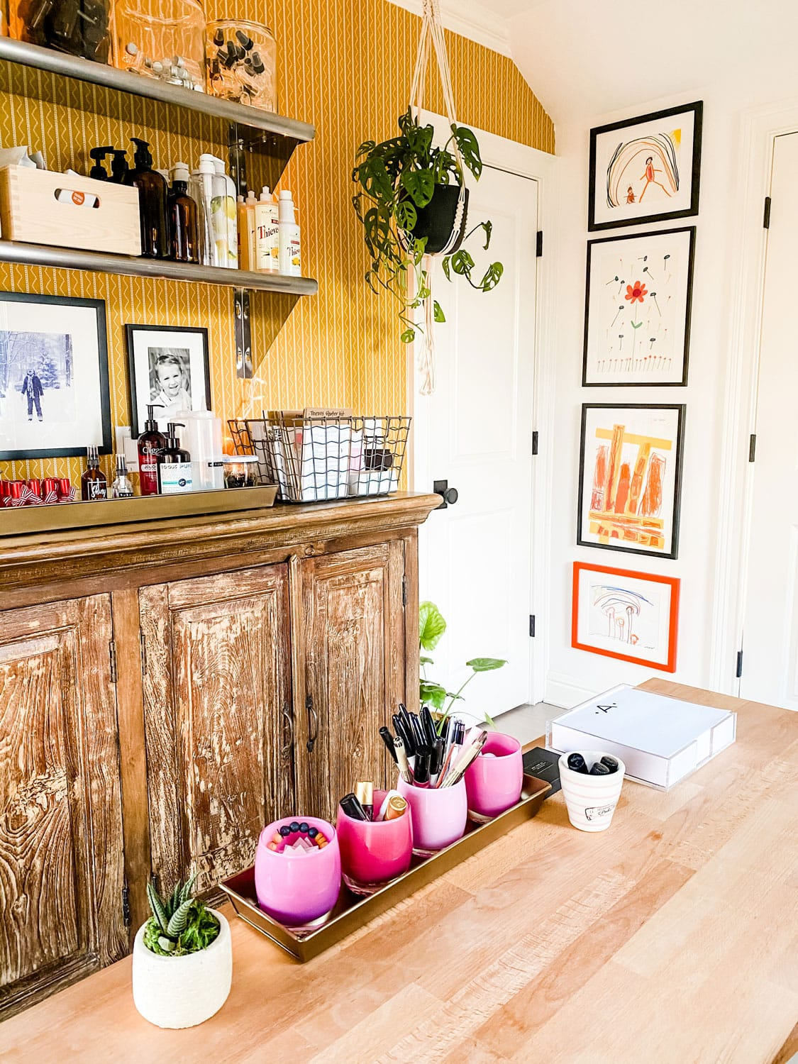 desk accessories and kids art on wall