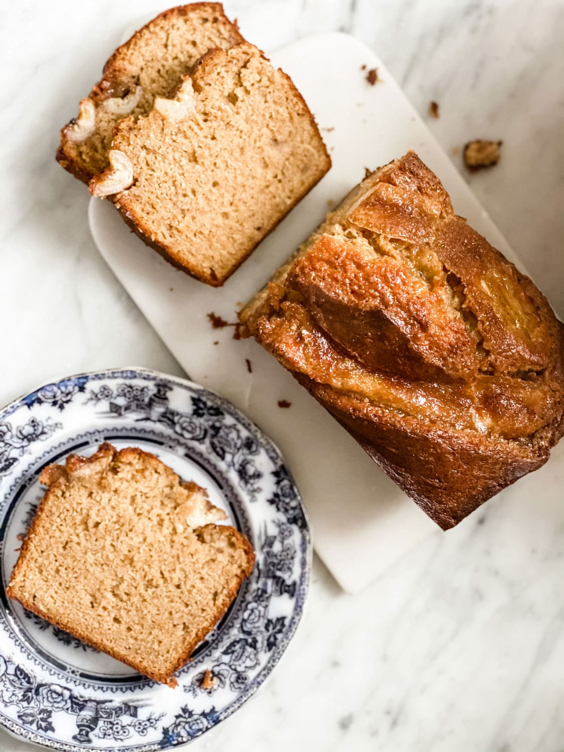 banana bread on black and white ironstone plate