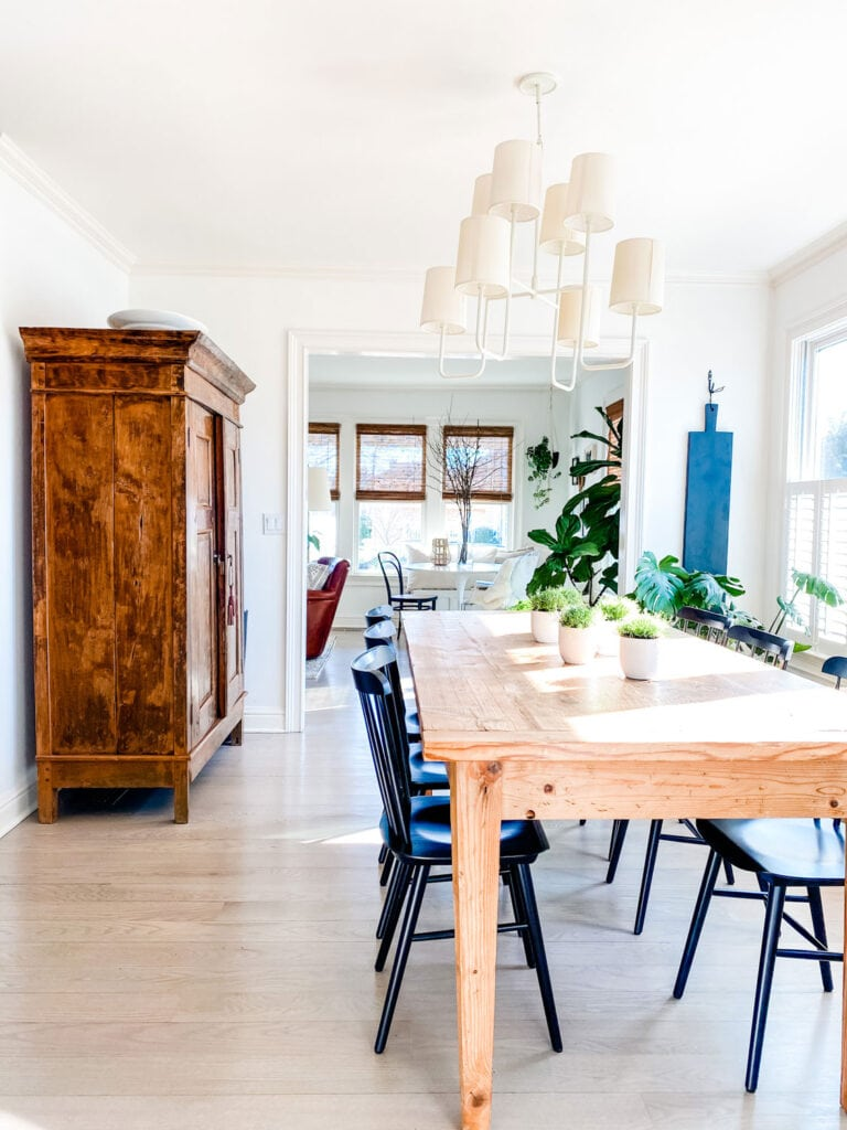 farm table, armoire, spring table, chandelier with shades