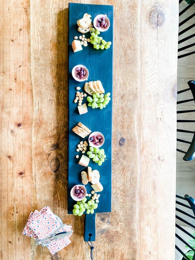 farmhouse plank with charcuterie on farm table in dining room