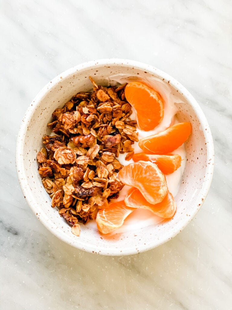 granola, tangerine sections in small. bowl