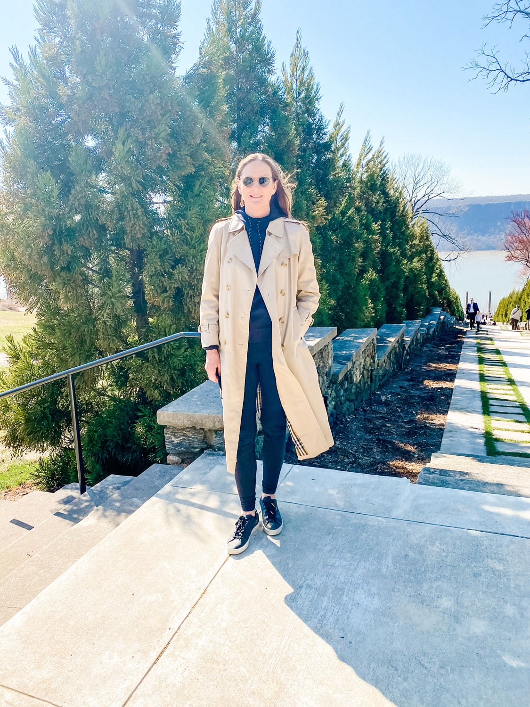 long length burberry coat on woman wearing black