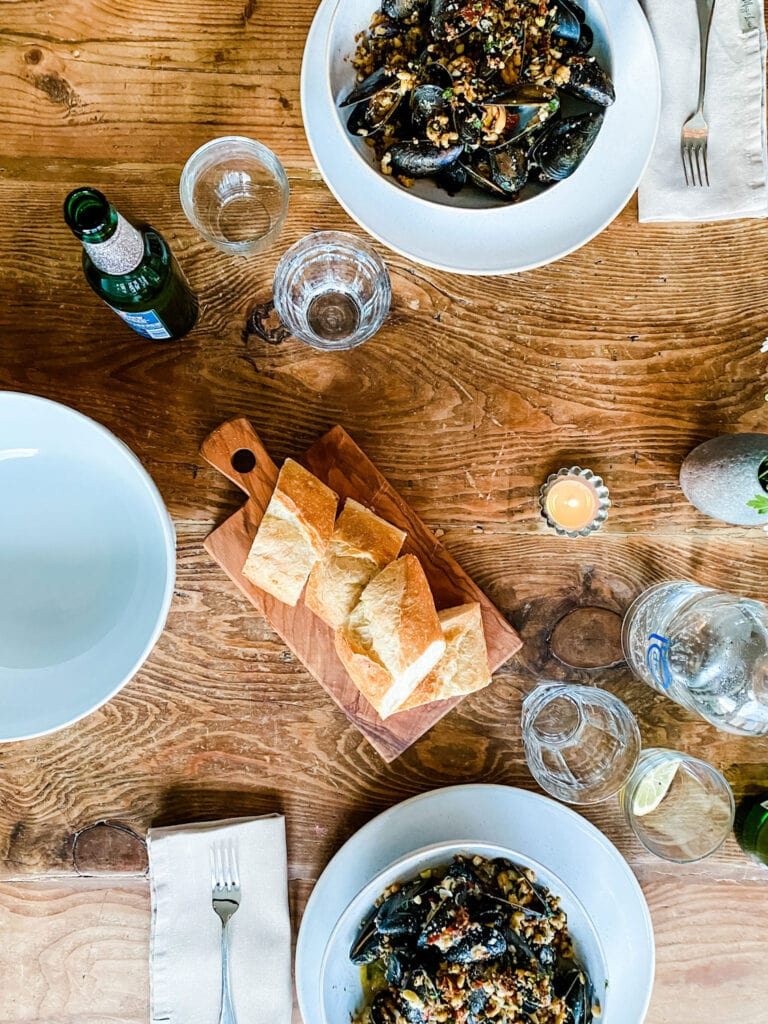 table setting with mussels and bread votive