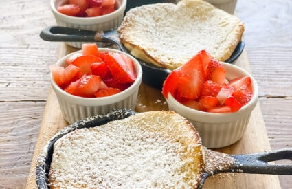 dutch baby pancakes, strawberries in small ramekin
