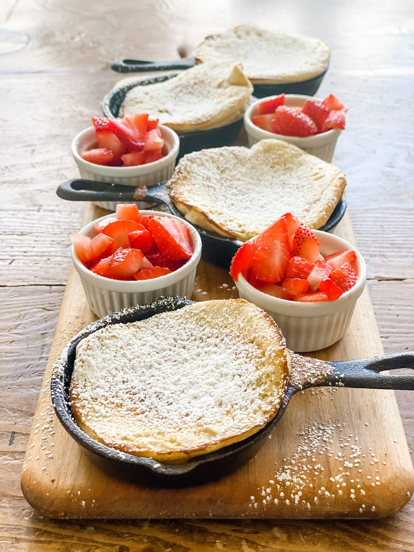 dutch baby pancakes, strawberries in small ramekin